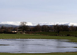 A photo of Kinder Scout taken from Church Lane in Woodford, Cheshire taken by Evelyn Frearson