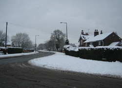 Junction of Moor Lane and Chester Road looking towards Moor Cottage and down Chester Road in Woodford, Cheshire taken by Ruth Jones
