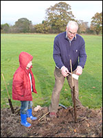 Mathew Horrocks planting a jubilee tree with his grandad Brian Horrocks a member of the Woodford Community Centre management committee