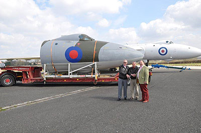 Vulcan nose cone and cockpit with Harry Harvey (Avro Heritage Ltd, Site owners), Harry Holmes of the Avro Heritage Centre, and Paul Rodman, Chairman of Woodford Community Council